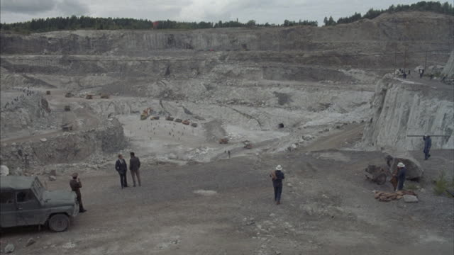 Workers at a open pit mine.