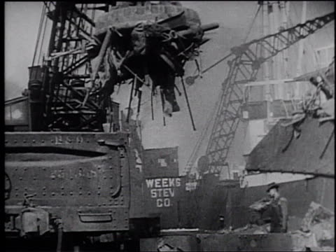 1945 montage workers at a scrap metal facility at a shipyard - frank capra video stock e b–roll
