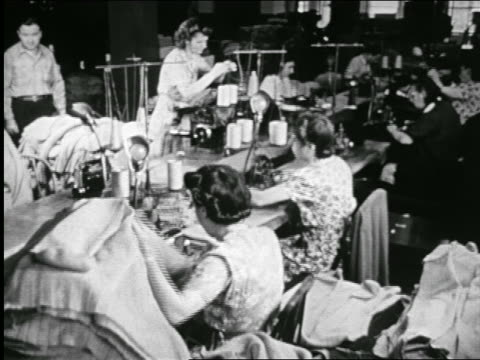 b/w 1946 workers at bobbins machines handle sweaters at clothes manufacturing plant / documentary - textile mill stock videos & royalty-free footage