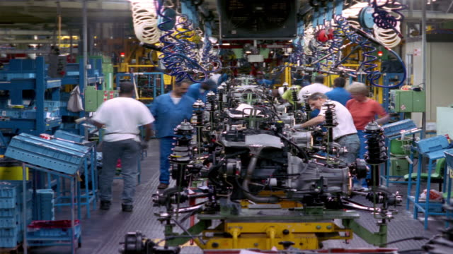 t/l, ms, workers at car engine assembly line, dagenham, england - car plant stock videos & royalty-free footage