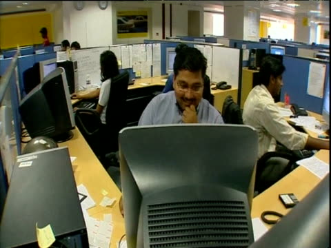 Workers at computers in modern office Bangalore