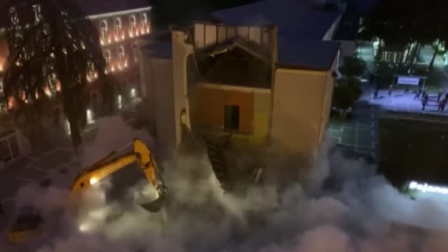 workers at dawn began tearing down the historic national theatre in the capital's main square constructed in 1939 by italians occupying albania at... - tirana stock videos & royalty-free footage