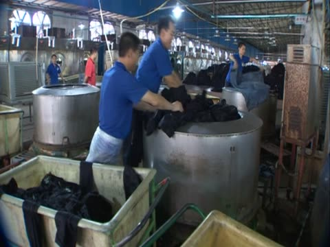 vídeos de stock, filmes e b-roll de workers at denim factory in xintang, southern china - jeans