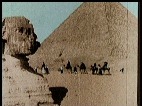 workers at great pyramid / sphinx / groups arrive on horseback - 古代の遺物点の映像素材/bロール