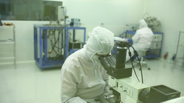 workers at medical equipment factory - clean room stock videos and b-roll footage
