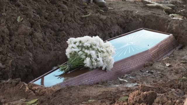 workers at rio de janeiro's largest cemetery bury victims of the novel coronavirus after very brief funerals attended by less than a dozen people, as... - dozen stock videos & royalty-free footage