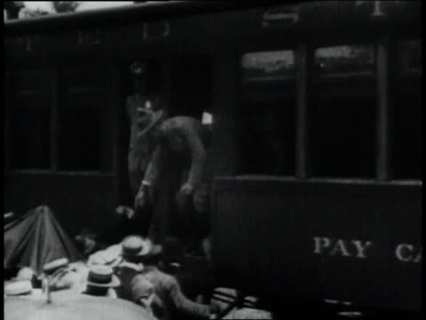 montage workers at the panama canal gather at the pay car man in a tie sorting through envelopes / republic of panama - anno 1906 video stock e b–roll