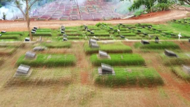 workers at the pondok ranggon cemetery in jakarta were busy on sunday digging new holes and burying the coffins of covid-19 victims as the global... - cemetery stock videos & royalty-free footage