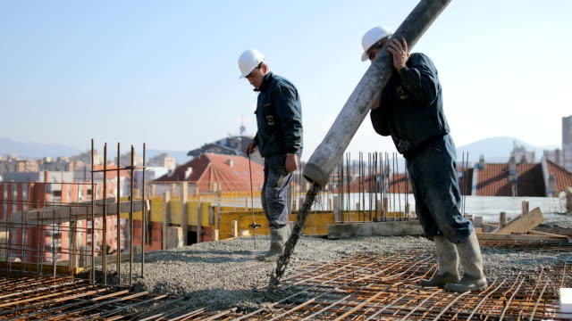 workers at the top of the building pouring concrete - danger stock videos & royalty-free footage