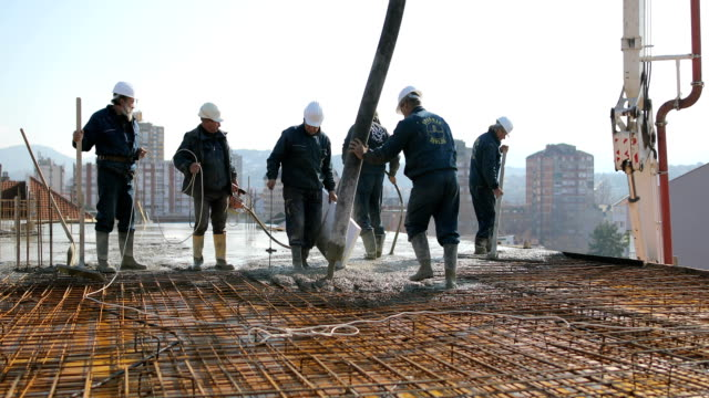 workers at the top of the building pouring concrete - helmet stock videos & royalty-free footage