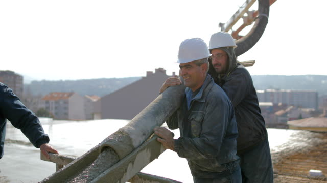 workers at the top of the building pouring concrete - boot stock videos & royalty-free footage