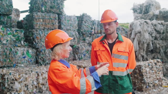 workers at waste reduction facility walking in loading dock - waste management stock videos & royalty-free footage