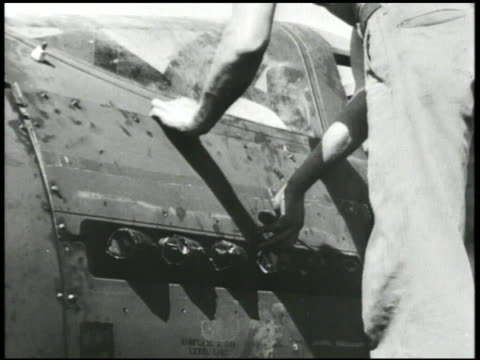 s workers attaching tail rudder part placing electronic part into fuselage metal plating to engine compartment marking fuselage w/ chalk vs fighter... - airplane tail stock videos and b-roll footage