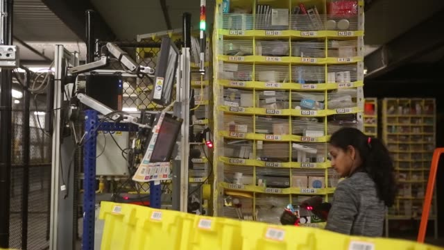 Workers attend to robotic pods at an Amazon Fulfillment Center in Robbinsville New Jersey Monday November 27 2017 Photographer Victor J Blue – Shots...