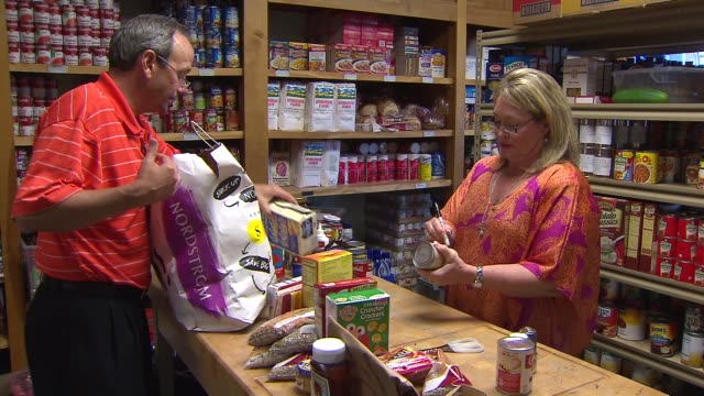 workers bagging items at food bank on september 06 2013 in chicago illinois - bagger stock videos & royalty-free footage