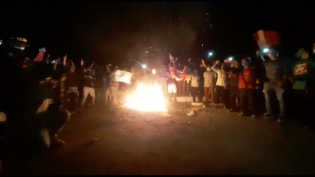 workers blocking peru's panamerican highway jump and chant around a fire after congress repealed the agricultural law, which they said limited their... - pan american highway stock videos & royalty-free footage