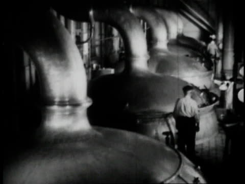 1936 b/w workers brewing beer at anheuser busch brewery in st. louis / missouri, united states  - anheuser busch brewery missouri stock videos and b-roll footage