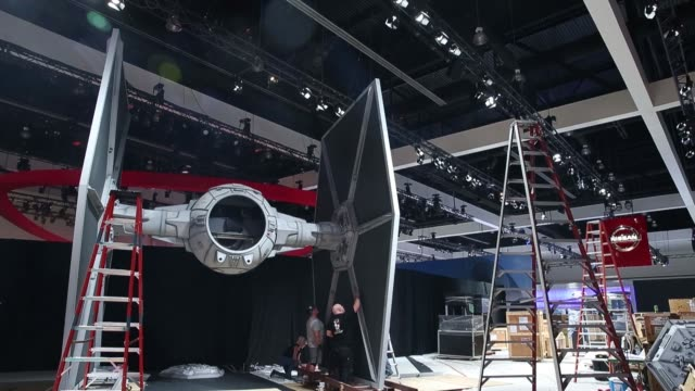 Workers build a Star Wars TIE Fighter to prepare for release of the 2017 Nissan Motor Co Rogue Rogue One Star Wars Limited Edition model sports...