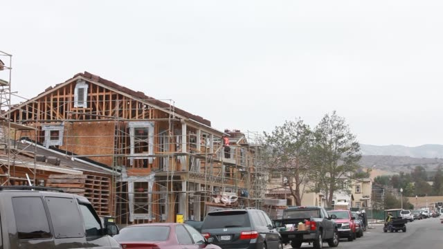 workers build new homes in the pavilion park development of the great park neighborhoods in irvine california us on thursday jan 30 a medium shot of... - irvine california stock videos & royalty-free footage