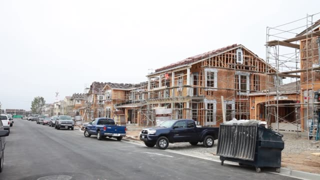 workers build new homes in the pavilion park development of the great park neighborhoods in irvine california us on thursday jan 30 a wide shot of a... - caulk gun stock videos and b-roll footage