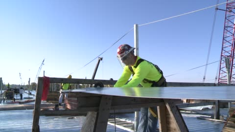 workers build new interstate highway bridge over mississippi river in missouri. - bridge built structure stock videos & royalty-free footage