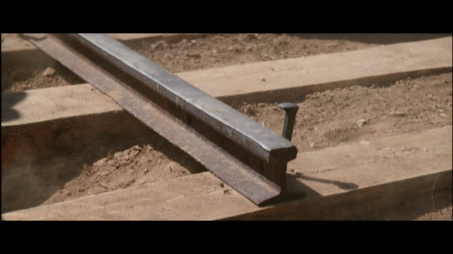 cu, tu, zo reenactment workers building railroad track, usa - terreno accidentato video stock e b–roll