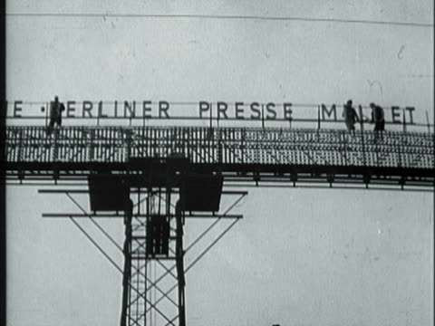 workers building sign board / people reading sign board / view of sign board about general macarthur - general electric building stock videos and b-roll footage