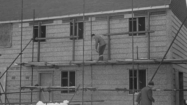 1947 montage workers building the prefabricated airey house and testing its strength while experts watch / united kingdom - postwar stock videos and b-roll footage