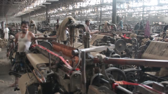 workers busy in making jute sacks at jute processing mill in narayanganj near dhaka.the jute industry in bangladesh is an industry that is... - biggest stock videos & royalty-free footage