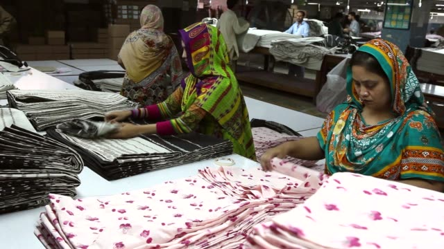 workers carry out quality control checks at dl nash ltd a textile manufacturer in karachi pakistan on saturday sept 10 2016 - textile mill stock videos & royalty-free footage