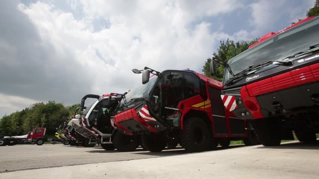 workers check the equipment on a new panther 6x6 fire fighting truck whilst on the production line at the rosenbauer international ag manufacturing... - fire engine stock videos & royalty-free footage