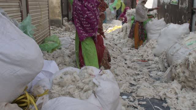 workers checking and sorting raw wool at a godown in dhaka, bangladesh on march 15, 2021. - textile industry stock videos & royalty-free footage