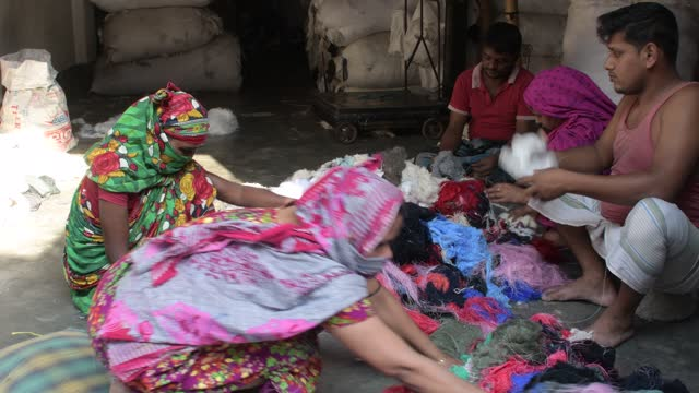 workers checking and sorting raw wool at a godown in dhaka, bangladesh on march 15, 2021. - softness stock videos & royalty-free footage