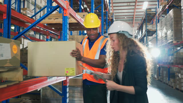 workers checking goods stock on shelf in warehouse. - quality control stock videos & royalty-free footage
