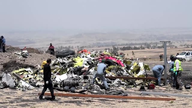 workers clean debris at the site of the deadly ethiopian airlines crash that killed 157 passengers and crew in ethiopia - ethiopia stock videos & royalty-free footage
