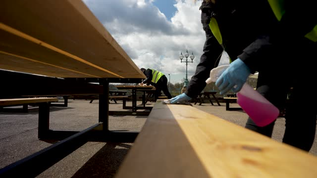 workers clean seats before the first customers come at alexandra palace the terrace bar on april 12, 2021 in london, united kingdom. england has... - concepts & topics stock videos & royalty-free footage