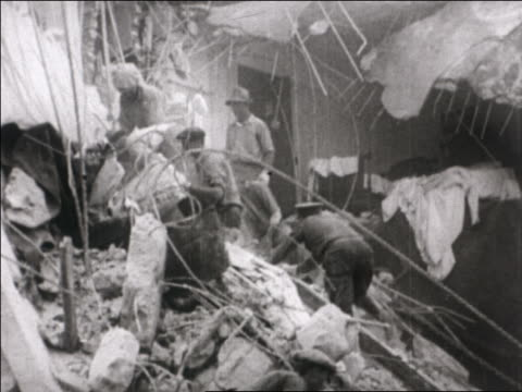 workers clearing debris from destroyed building after earthquake / santa barbara, ca - 1925 stock videos & royalty-free footage