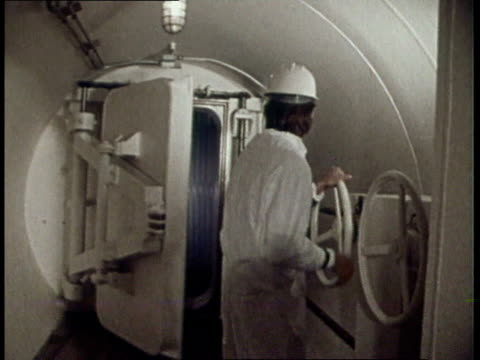 1974 ds workers closing doors in plant - nuclear power station stock videos & royalty-free footage