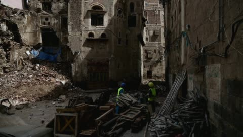 workers collect ruins of a building from the historic old quarter of sana'a still standing as recent rains have threatened the city's heritage sites... - unesco world heritage site点の映像素材/bロール