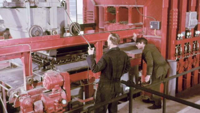 stockvideo's en b-roll-footage met montage workers conducting experiment to investigate the production of concrete panels at the building research establishment / garston, england, united kingdom - 1970