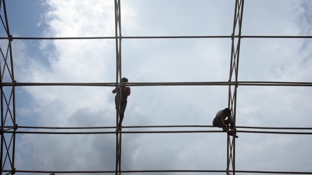 workers construct a temporary quarantine facility and hospital for coronavirus or covid19 patients at nehru stadium in guwahati sunday july 26 2020 - {{relatedsearchurl(carousel.phrase)}} stock-videos und b-roll-filmmaterial