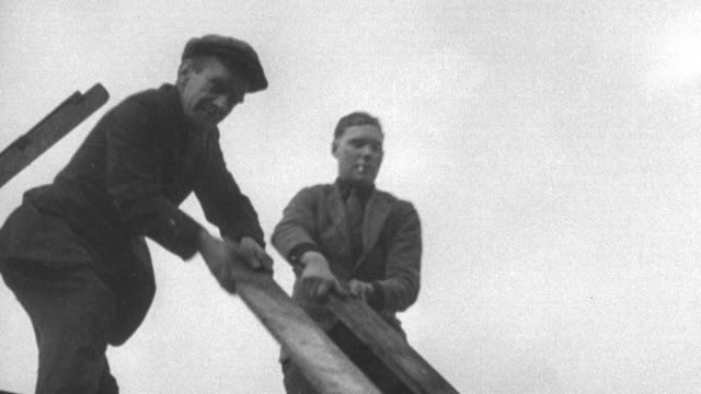 montage workers constructing a community center / united kingdom - 1937 stock videos & royalty-free footage