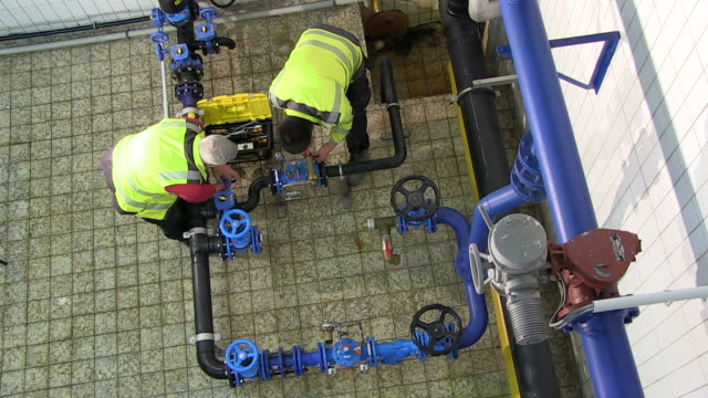 ms workers controlling wheel valve of pump station at water reservoir / konz, rhineland-palatinate, germany - machine valve stock videos & royalty-free footage