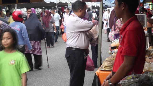 workers cook up food to sell to shoppers and pedestrians as they walk through a market in johor bahru johor malaysia on friday july 10 2015 shots cu... - johor stock videos & royalty-free footage