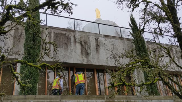 workers cover ground floor windows with plywood at the state capitol building on january 15, 2021 in salem, oregon. oregon governor kate brown... - salem oregon stock videos & royalty-free footage