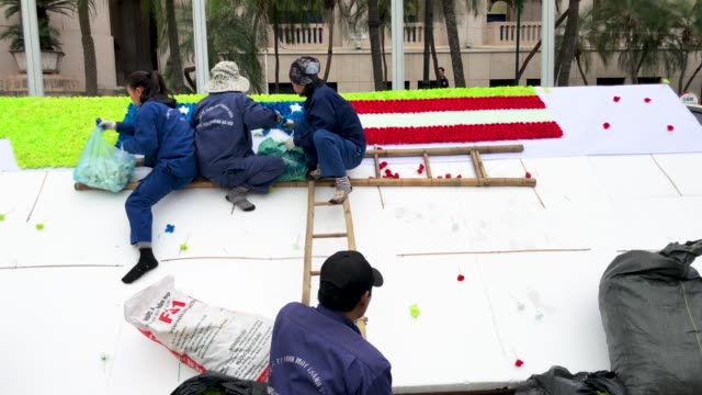workers create a flower arrangement displaying the dprk and united states flags ahead of the forthcoming dprkusa summit on february 25 2019 in hanoi... - north vietnam stock videos & royalty-free footage