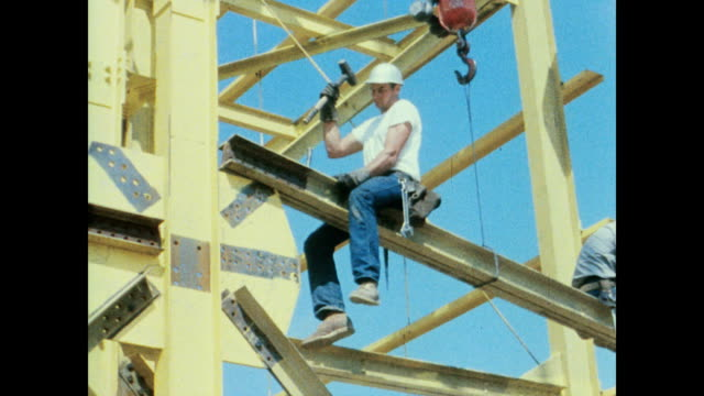 workers create the framework of the radar including excavation, erection of steel work, surveying and aligning of each member on the 45dg scanner... - erektion stock-videos und b-roll-filmmaterial