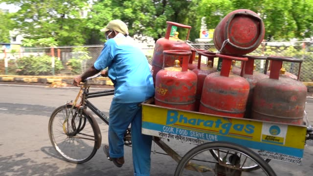 workers delivering home cooking lpg gas cylinders to customers - flammable stock videos & royalty-free footage