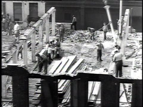 stockvideo's en b-roll-footage met 1937 montage workers demolishing a building / united states - 1937