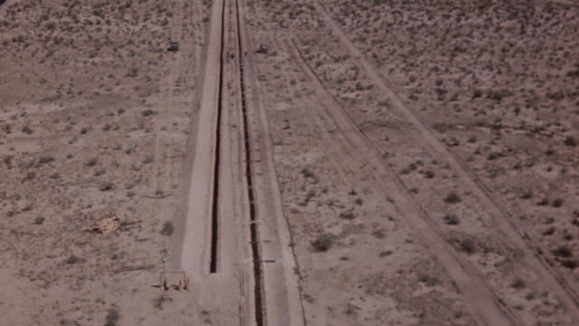 workers digging long narrow trenches across the white sands test site / new mexico united states - white sands missile range stock videos & royalty-free footage